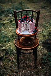 berry topped naked wedding cake for a forest elopement