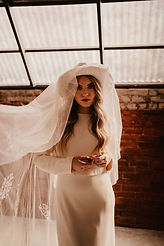 modern bridal look of hat and fedora
