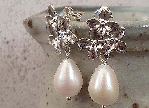 Silver flower pearl drop earrings