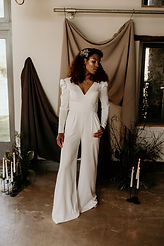 modern bridal jumpsuit with statement jewellery and layerd gypsophila hair pins made by The Lucky Sixpence