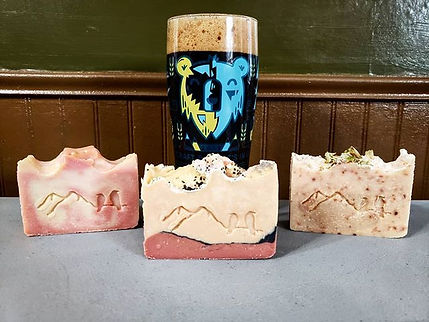 A pint of beer with three bars of beer soap.