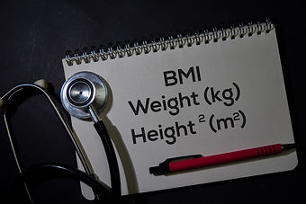 BMI - Weight and Height write on a book