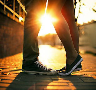 Young couple kissing outdoor in summer s