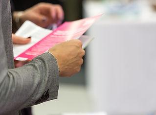 Female holding a leaflet, close up, blur