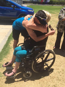 Morné Basson with a MND patient in Cape Town.