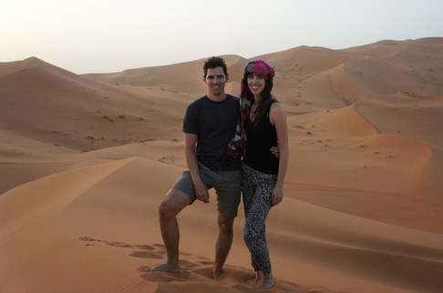 We got off the camels and climbed to the top of a dune for better sunset viewing.