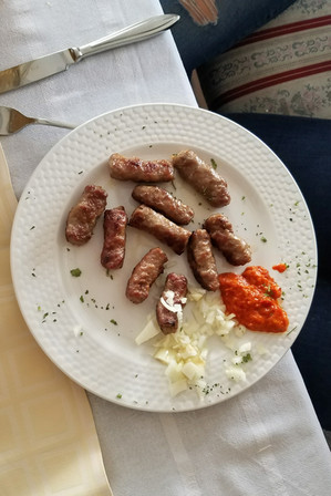 Cevapi, little sausages with red pepper sauce