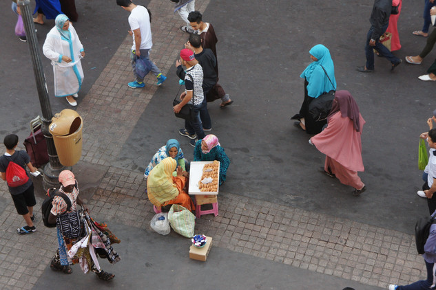 Ladies selling cookies in the street. They come out every night and sell chewy coconut cookies for twenty cents.
