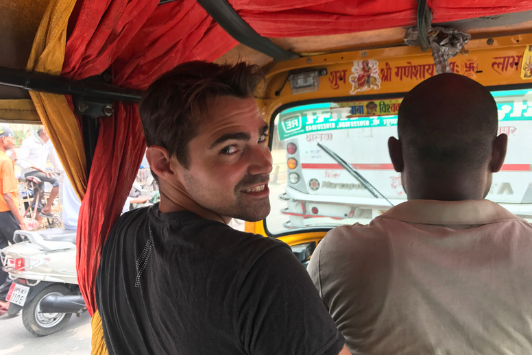 Taking a tuk tuk from the station to where we heard there was a bus