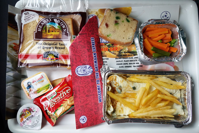 The train from New Delhi to Agra is fancy compared to other trains, we learned. Our tickets were $7 or so and included this huge breakfast.