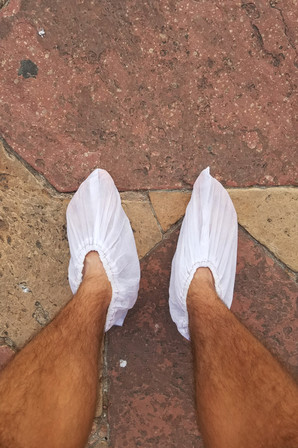 In order to go in the Taj Mahal, you have to take off your shoes. Yusuf handed us these shoe covers to put on our bare feet, then put our sandals in a cloth bag he'd brought so we didn't have to leave them in the cubbies.