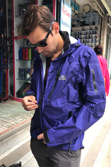 Trying on some of the knockoff-brand hiking gear you can find all over Kathmandu.