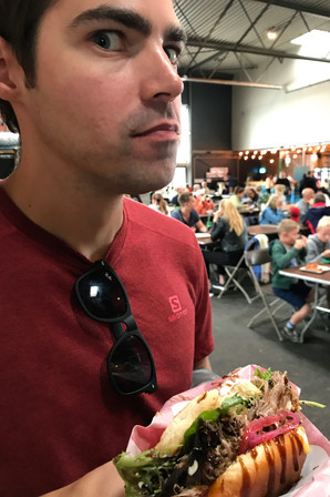Brandon eating a duck burger
