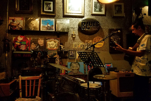 I found a blues bar, where this guy played Bob Dylan and a bunch of other great stuff.