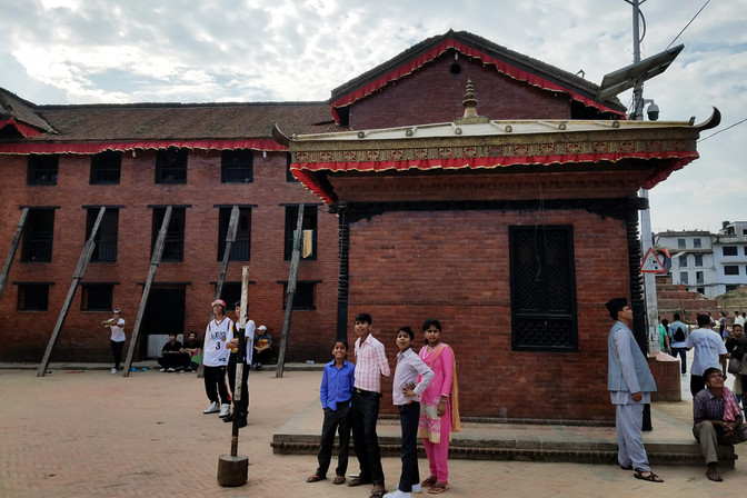 Many of Kathmandu's temples and historic buildings were damaged in a 2015 earthquake.  The rubble has been cleared away, but lots of structures are still propped up with wooden beams.
