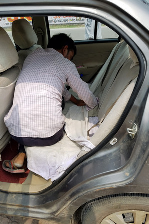 The taxi had a nice cover on the backseat, which meant we couldn't find the seatbelts. After a few minutes of negotiating, our poor driver dug the seatbelts out for us. I'm sure he thought we were crazy, but the drive ended up taking eight hours on some wild roads — we were glad to be strapped in.