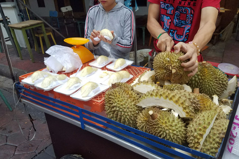 """We walked around for awhile looking for a hotel. One of my goals was to try durian, """"the king of fruits."""" It's really smelly, but apparently the creamy custard texture and flavor make up for it. I think we took this picture but didn't buy any yet."""