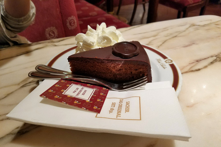 Trying the famous sachertorte. It's delicious, but a bit on the dry side for Americans, I think.