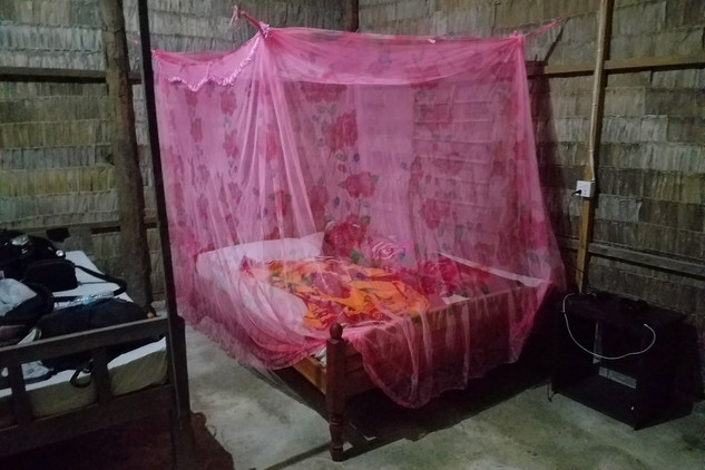 Our bed inside the spacious grass guesthouse. Don't worry, we didn't really need that mosquito net.