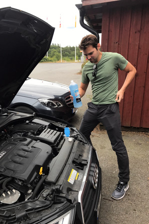 Brandon filling up the washer fluid when we stopped for lunch