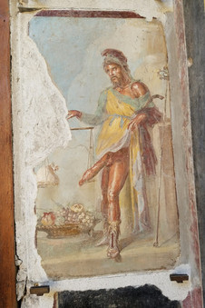 Pompeii was big into phallic art. This is a fresco of Priapus, god of sex and fertility.