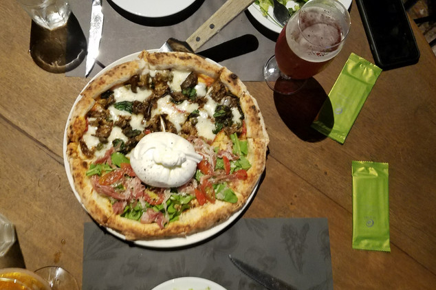 Our pizza had burrata in the middle