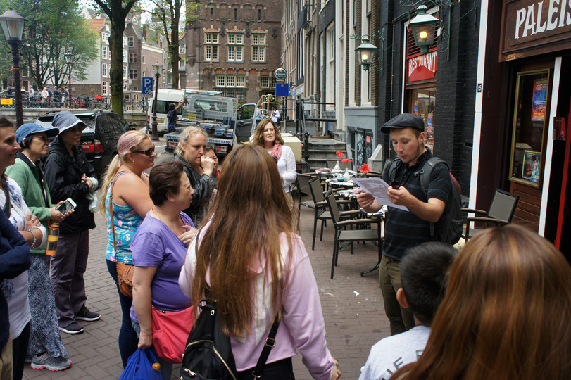Our walking tour guide telling us about his stand up comedy show that night
