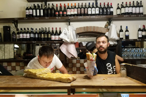 The admirable men of All'Antico Vinaio, the best sandwich shop in Florence. There's always a huge line out the door, but they work fast and sandwiches are only €5.