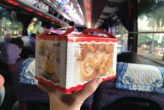 The bus company provided cute snack boxes full of pastries. We learned that we were going to be in Phnom Penh for Cambodia's biggest holiday, Bon Om Touk (the water festival).
