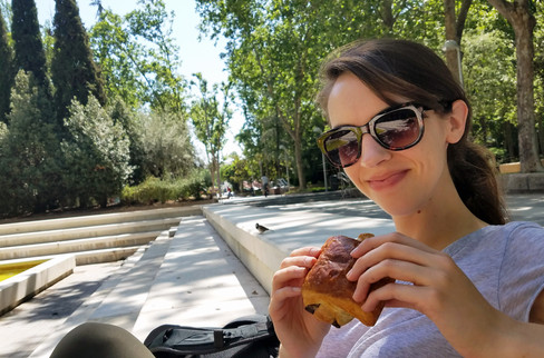 Eating a chocolate croissant in the park while trying to find an Airbnb the first day