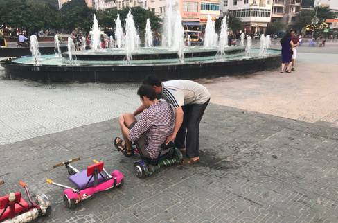We kept seeing kids ride around on these modified hover boards, and Brandon wanted to try. We found a guy in the main square who sold us 20 minutes and gave us a tutorial.