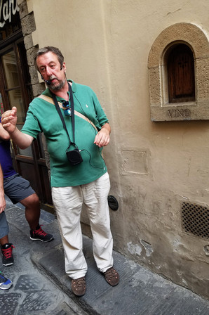 Our guide explaining that this tiny door used to be a walk-up wine bar.