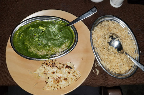 Eating dinner at the Indiana Restaurant. This is Brandon's palak paneer; regrettably my stomach was still messed up and I ordered some sort of noodle soup with cooked lettuce in it.