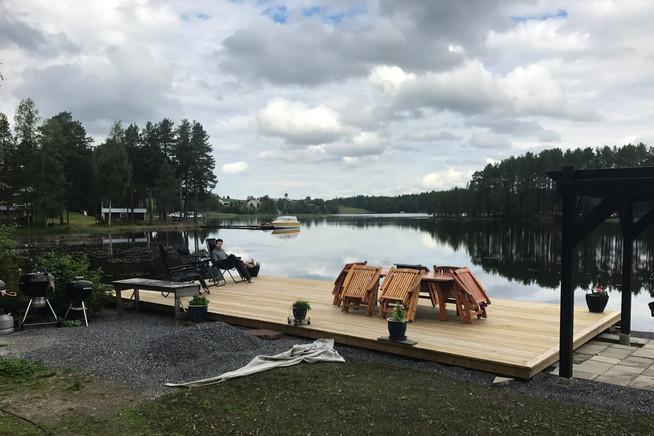 Brandon reading by the lake