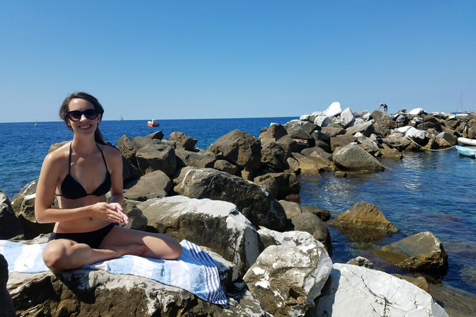 """As soon as we got off the train in Riomaggiore (the southernmost town), Brandon saw the """"beach"""" (i.e. these rocks) and had to go snorkel."""