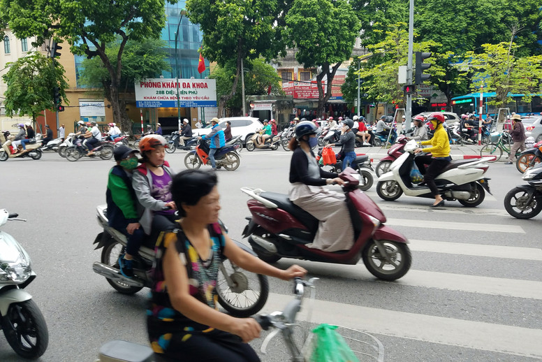 A very rare crosswalk — which no one pays attention to. To cross the street in Vietnam, you find a small gap between bikes and start walking. The other bikes zoom expertly around you.