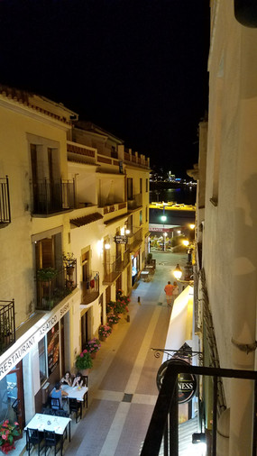 We arrived at night and had trouble finding our place — it was hidden behind a pizza restaurant. This is the view from the balcony.