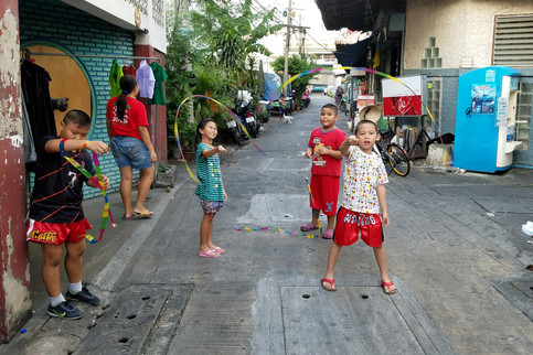Some kids showing us their ribbon dancers on the way back to the hotel
