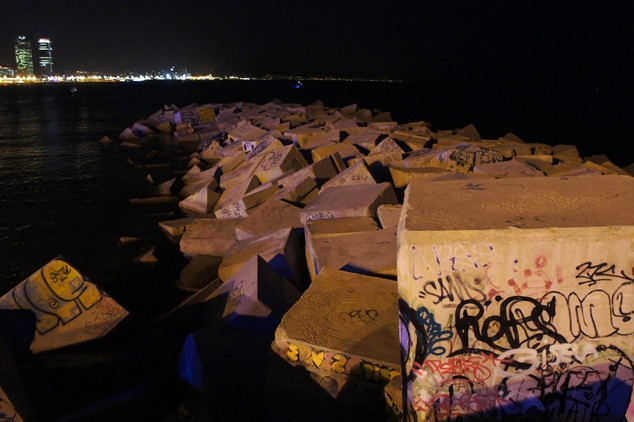 As it turned dark, Brandon spotted a climbing opportunity nearby: this concrete block jetty. We climbed out on it to listen to the end of the concert.