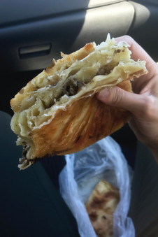 Eating burek and trying to dip it in yogurt as we drove was a tad difficult, but we managed.
