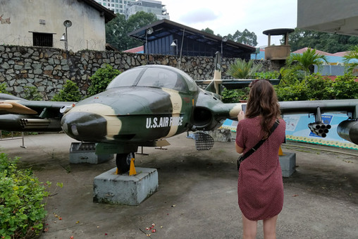Visiting the War Remnants Museum, which had several American planes that had been shot down during the war.
