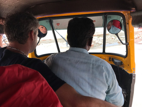 Sharing a tuk tuk to get to our guest house