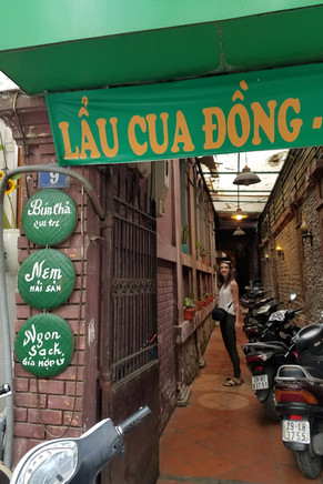 Headed down an alley to get some bún chả