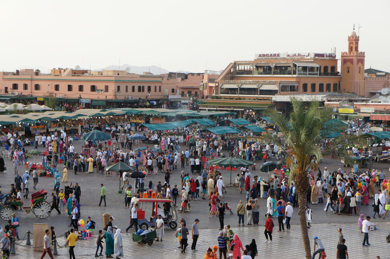 Jemaa el-Fnaa square, where we met our riad host so he could show us the way to the hotel. We were a couple hours late because a girl in our van had gotten really carsick on the hilly roads and had to stop several times to throw up. (She was the only local in the van; the rest of us were tourists. We tried giving her water and GinGins, but it was pretty hopeless and obviously miserable...we felt so bad).