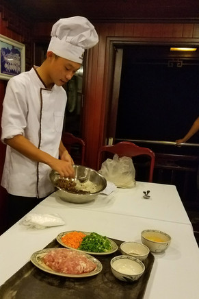 Making pork rolls in our onboard cooking class