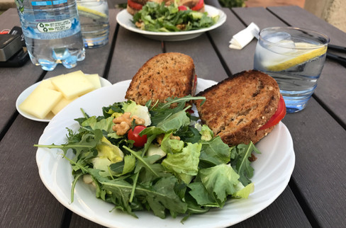 Eating tomato sandwiches in the garden