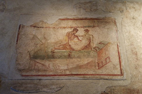 One of the brothels is well-preserved with its menu of offerings still painted in fresco on the walls.