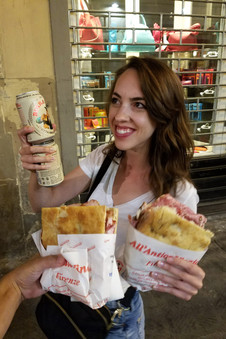 Inordinately pleased with our giant sandwiches and cans of Moretti, which we enjoyed on the curb.
