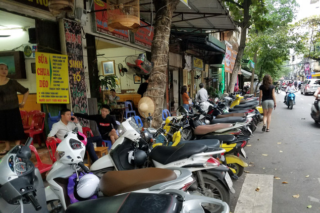 It's hard to find space to walk, since the sidewalks are taken up by people eating dinner on tiny plastic chairs, the roadsides are filled with parked motorbikes, and the streets themselves are in constant rush hour.