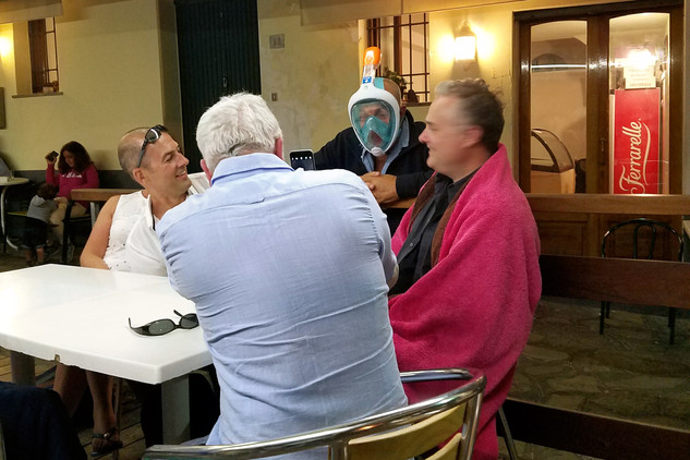 We stopped at a little family restaurant on the way back to our apartment and chatted with the owner (pictured in the snorkel mask)